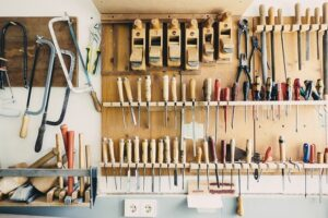 Organized tools on the wall of a garage.