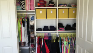 Picture of a well organized kid closet to show kid friendly closet organication.